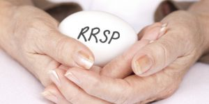 Elderly female hands with RRSP egg